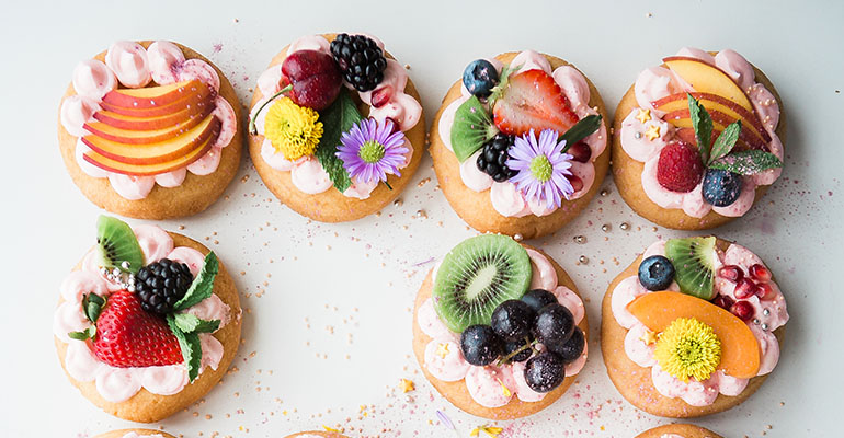 Assorted donuts top of white area in Cheapest price